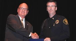 POLC Labor Rep. Frank Klik (left) presents Macomb Police Academy graduate Matthew McPhillips with a LEEP Award.