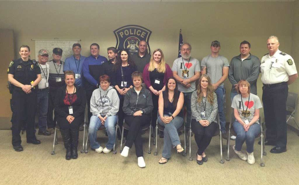 Photo courtesy of Chesterfield Township Police Department Chesterfield Township Police Chief Brad Kersten (at right) and Sgt. Tiffany Krul (left), who organized and oversaw the inaugural Citizens Police Academy, take a moment to pose with participants.